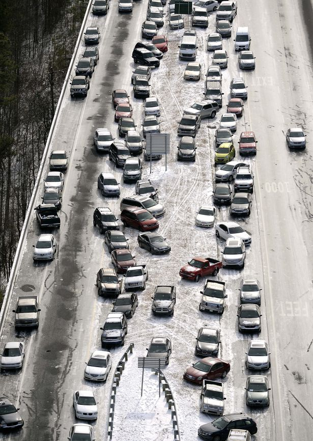 Atlanta, snow, traffic, SnowJam, ATLSnow, disaster, winter storm, havoc, mayhem, Kasim Reed, Nathan Deal, Atlanta mayor, Georgia, governor, highways, AJC, WSB, baby born on highway, I-75, I-85, I-285, Perimeter