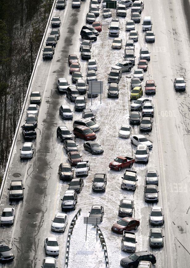 Atlanta, snow, traffic, SnowJam, ATLSnow, disaster, winter storm, havoc, mayhem, Kasim Reed, Nathan Deal, Atlanta mayor, Georgia, governor, highways, AJC, WSB, baby born on highway, I-75, I-85, I-285, Perimeter