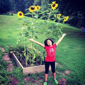 Bella Ortega, flowers, sunflowers, kid, child, girl, garden, gardening, happy, smile, story elements, perfect little story